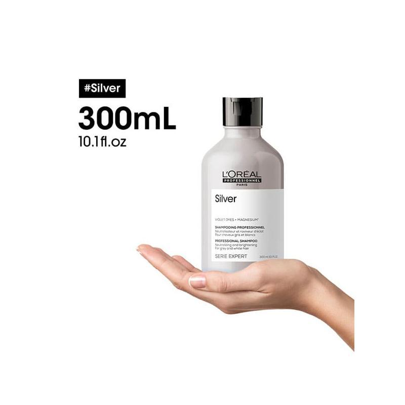 3474636974115-silver-shampooing-neutralisant-cheveux-gris-blancs-l-oreal-professionnel-reflets-jaunes-violet-sur-une-main